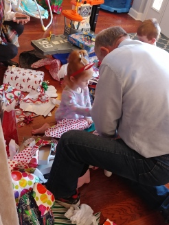 Papa helping with presents